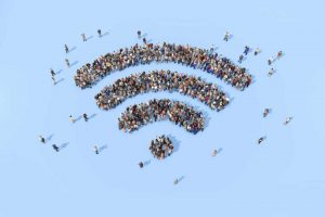Large collection of people grouped together to form a wifi symbol